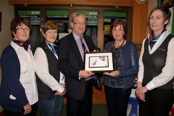 Presentation by Frank Curtin to Patricia of the three official Irish Christmas Stamps.  Also included are the wonderfully dedicated Staff of Millstreet Post Office - from left:  Ann, Noreen, Patricia and Margaret.