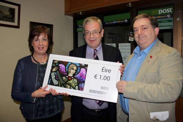 At the Millstreet Launch of the Bill Power An Post Millstreet Stamp on 1st Dec. 2014.  From left: Patricia Moynihan (Post Mistress), Frank Curtin (An Post, Cork GPO) and Bill Power, Photographer of the renowned Christmas Stamp 2014.   An amazing 3.7 million Millstreet Stamps have now been sold and have gone worldwide.  Click on the image to enlarge.  (S.R.)