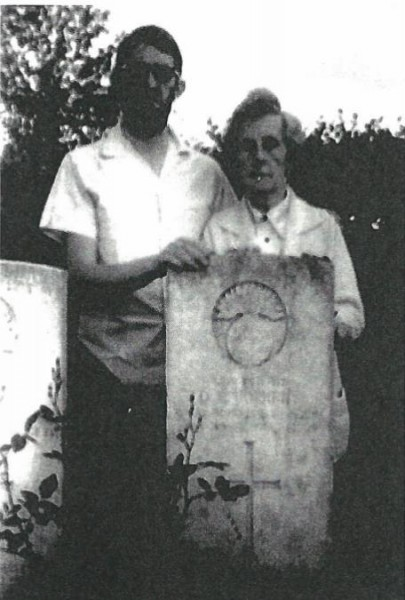 2014-12-07 Pte Daniell Corkery - nephew Kevin O'Byrne and sister Rita at his grave at Tincourt