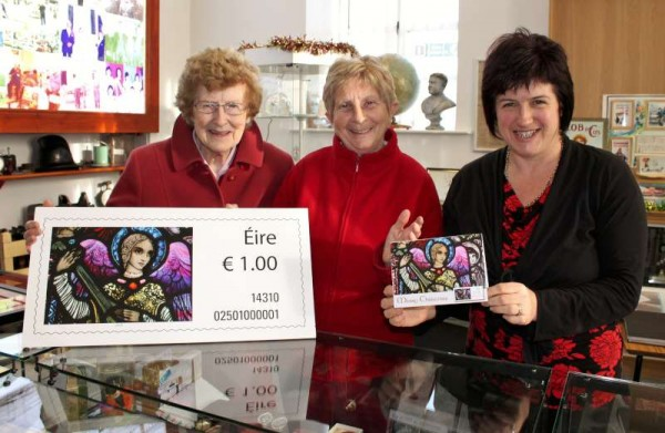 In addition to the GPO Christmas Stamp Enlargement we now have a treasured Christmas Card of the Stamp designed by Bill Power himself and who kindly posted it to us today.   We were delighted to welcome (from left) Mai O'Hanlon of Rathmore and Teresa Coffey of Killarney & Millstreet where Mary Cronin displayed the new Bill Power Card to the special Visitors.  Click on the image to enalrge.  (S.R.)