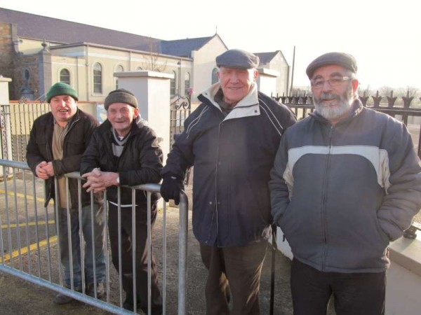 With a chill in the air on this beautiful sunny January morning the four gentleman are wise to wear appropriate head attire - pictured at West End, Millstreet.  Click on the image to enlarge.  (S.R.)