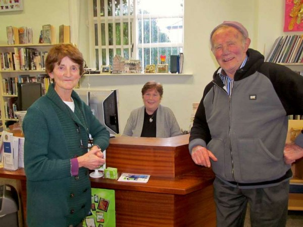 To celebrate St. Brigid's Day 2015 Breeda Kelleher (pictured here on left today at Millstreet Library with Breda and with Denis J.Kelleher) arranged to make some 100 miniature St. Brigid Crosses for distribution at Mass. Breeda has been doing this wonderfully kind gesture for many years as did the late Teresa Tangney with a group of voluntary Helpers.  Millstreet Church has not just a very impressive large statue of the Saint but also an exquisite stained glass window.  Click on the images to enlarge.   (S.R.)