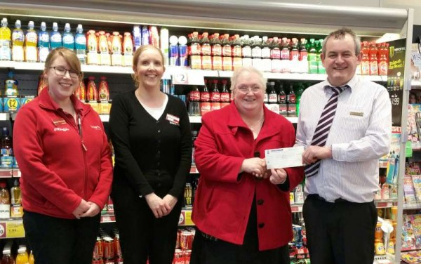 Following the pre-Christmas 2014 Fundraising Staff Jumper Day Manager of Supervalu Joe Fitzgerald presents a cheque to Matron Lena Kelleher for Millstreet Community Hospital.  We thank Rachel for the photograph.  Click on the image to enlarge.  (S.R.)