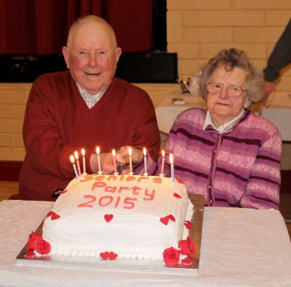 Cutting the cake as the most senior Guests at the annual Seniors' Party held at Dromtariffe Community Hall on Sunday, 15th February 2015....Denis O'Leary of Coolclogher who is in his 90th year and Julia Duggan of Dromagh who is 94 years young.  Click on the images to enlarge.  (S.R.)