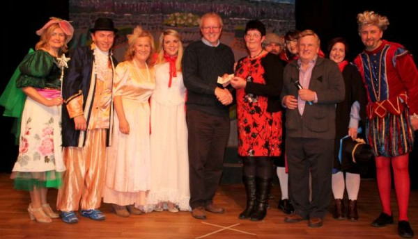 "Eilish Coakley on behalf of Rathmore's Marian Players presented a hugely impressive cheque for €17,000.00 - the result of this year's ""Little Red Riding Hood"" 2015  Pantomime - to Kerry Parents and Friends Association following the  final presentation of the magnificent Show in Rathmore Community Centre on Monday night.   Click on the images to enlarge.  (S.R.)"