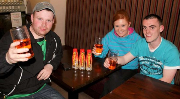 "Michael Walsh celebrates his magnificent win with his Friends Jarleth & Lynn O'Sullivan.  It's a ""Lucozade"" celebration!"