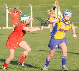 2015-03-22 Chloe Collins tackles Emma Kennedy in the U16A Munster Camogie Final