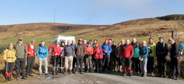 "Wonderfully energetic participants pictured near Mullaghanish's RTÉ Television Mast at the beginning of the strenuous ""A"" Walk ""The 3 Peaks Challenge"" on Saturday morning (11th April 2015).  Millstreet Walking Festival continues today (Sunday) with registration and deregistration at Millstreet Country Park.  Click on the image to enlarge.  (S.R.)"