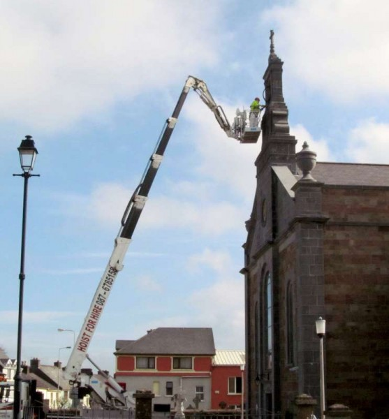 "The impressive scene outside St. Patrick's Church, Millstreet this Wednesday morning (8th April 2015) with Martin Leader's Hoist in place - not to check out the ""Golden Eagles"" location as people humorously surmised - but rather the continuation of Church maintenance near the bell tower.  Click on the images to enlarge.  (S.R.)"