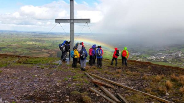 "Thanks to Joe Fitzgerald we are given the wonderful opportunity to view some remarkable images from the ""Three Peaks Challenge"" of the recent Millstreet Walking Festival.  Here, for example, the exquisite view of a rainbow as seen by energetic walkers from the Cross on Clara Mountain.  And, below, the Mast at Mullaghanish.  Click on the images to enlarge.  (S.R.)"