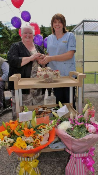 Matron Lena Kelleher (on left) hands over the official keys to new Acting Matron, Noreen McSweeney at Lena's recent Retirement Reception in Millstreet Community Hospital.