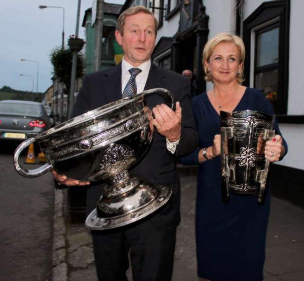 "Taoiseach Enda with ""Sam"" (a superb replica cup made in Glenflesk) while Deputy Áine hold the replica Liam McCarthy Cup.  Click on the images to enlarge.  (S.R.)"