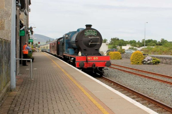 For a very brief period at Millstreet Railway Station the magic of Steam emerged as a magnificent Steam Train passed through coming from Killarney.  Click on the images to enlarge.  (S.R.)