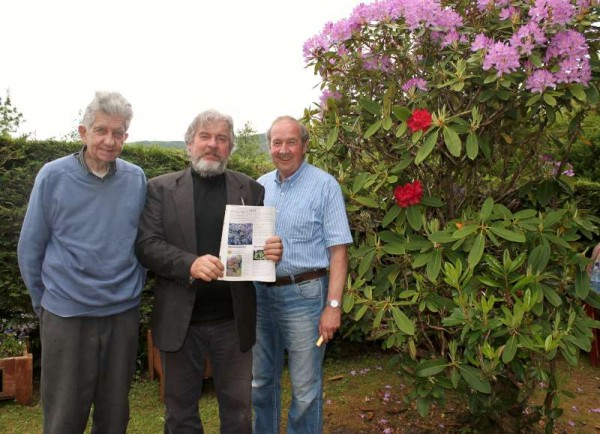 "A purple and red Rhododendron which is beautifully located on the Grounds of Tubrid |Holy Well has featured as a prize-winning photograph in the May 2015 issue of ""The Irish Garden"".  We thank James O'Sullivan for alerting us to this very interesting feature.  Pictured from left beside the very special Rhododendron - John O'Sullivan, Rathduane, James O'Sullivan and Pat O'Keeffe from Garryvoe.  Click on the images to enlarge.  (S.R.)"
