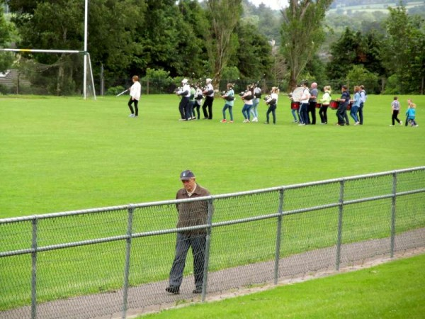 In preparation for next Sunday's Munster Football Final in Killarney (5th July 2015) Millstreet Pipe Band have been dedicatedly practising in the Town Park.  And we note three young wonderfully loyal followers supporting throughout the practice!  Click on the images to enlarge.  (S.R.)