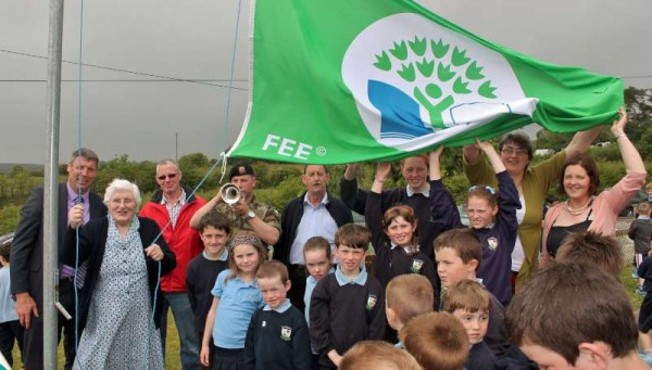 Christina O'Connell officially raises the Green Flag for Energy which has recently been awarded to Derrinagree N.S..  Click on the images to enlarge.  (S.R.)