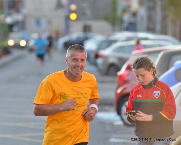 2015-07-29 Clara keeping her Dad on his toes last Friday night at the fun run in kanturk