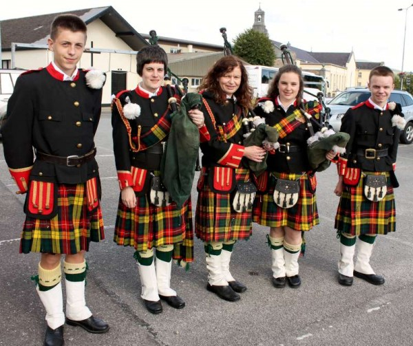 Members of Millstreet Pipe Band prepare to travel by coach to the Kingdom of Kerry for the official parade of the Rose of Tralee Festival 2015.   The Band has the unique honour of appearing at all of the 55 previous Tralee events.   Click on the images to enlarge.