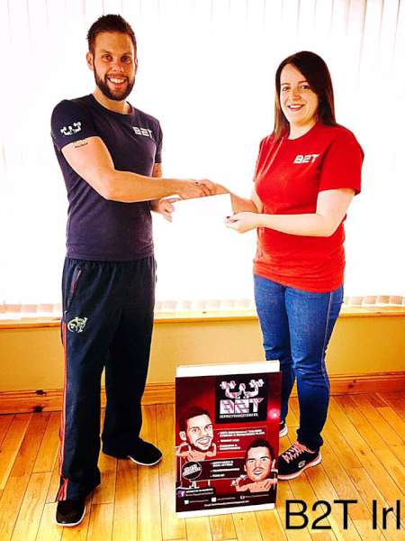 B2T Irl Team Member, Colin Mullane of Rathcoole, presenting Irish Kickboxing Athlete, Helen Cooney, with her sponsorship cheque & B2T T-Shirt as she prepares to fight in the World Kickboxing & Karate Championships in Orlando, Florida. Click on the image to enlarge. (S.R.)