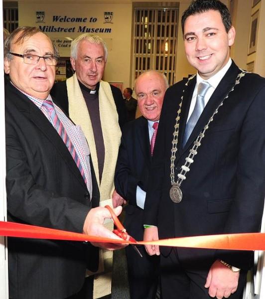 Noel Buckley cuts the tape officialy reopening Millstreet Museum, with Fr. John Fitzgerald, Seán Radley, and Cork County Mayor John Paul O'Shea - photo by John Tarrant