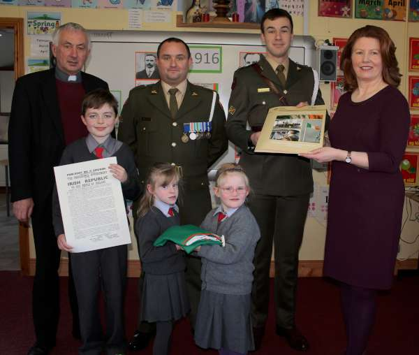 A truly impressive National Flag Ceremony took place in Cloghoula N.S. on Friday 20th Nov. 2015 when Lt. James McKeon from Dublin and Gunner Jimmy Donovan from Cork visited the School.   Click on the images to enlarge.  (S.R.)