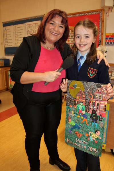 Broadcaster supreme RTÉ's Brenda Donohue interviewing the winner of the 2015 Colour My World Competition which is promoted by The Sunday World for the tenth year - Shelagh Jessica Gilbourne from Millstreet, Co. Cork - a pupil at Presentation N.S., Millstreet.
