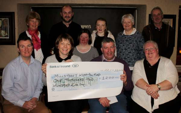 A very impressive cheque for €1,200.00 was presented at the Wallis Arms Hotel tonight to St. Joseph's Community Hospital, Millstreet by Aubane Social Club following the successful annual Halloween Fancy Dress Event some weeks ago.   Refreshments for those present tonight was kindly provided by Billy and the Wallis Arms Staff.  Click on the images to enlarge.  (S.R.)