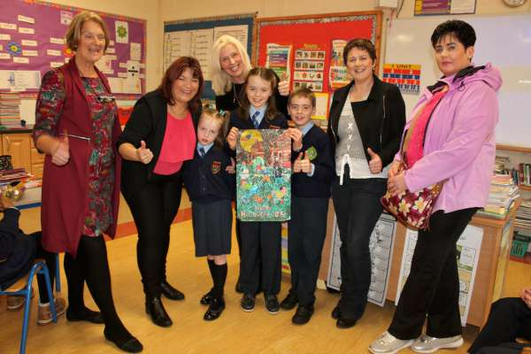 Pictured in Presentation N.S., Millstreet at the recent awarding of the overall prize to the winner of the 2015 Colour My World Competition which is promoted by The Sunday World for the tenth year - From left: Joan O'Mahony, Principal; Broadcaster supreme RTÉ's Brenda Donohue, Margaux Gilbourne, Gillian Gilbourne (mother), Shelagh Jessica Gilbourne (winner), Patrick Gilbourne, Nora Murphy (teacher) and Angela Kelleher (aunt).
