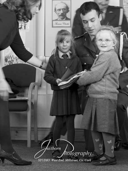Justin Black's superb black-and-white image of the acceptance of the National Flag at Cloghoula N.S. yesterday.   A full feature will be uploaded over the weekend.  (S.R.)