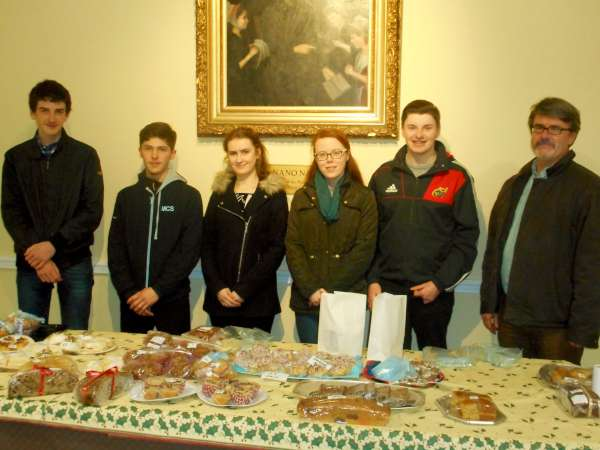 To assist in the fundraising for the Millstreet Community School Students travelling to Lourdes at Easter 2016  on the Irish Pilgrimage Trust journey a very successful Cake Sale was held in the Parish Centre after Mass tonight - Sat. 12th Dec. 2015.   Also included is School Chaplain, John Magee.  Click on the image to enlarge.  (S.R.)