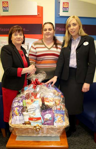 Helen O'Connor, Drishane View, Millstreet (pictured centre) receiving the magnificent AIB Christmas hamper which she won on 21st Dec. 2015.  Included also (on left) Kathleen Healy, Manager, AIB, Millstreet and Ciara O'Donovan. AIB.  Sincere congratulations to Helen.  Click on the image to enlarge.  (S.R.)