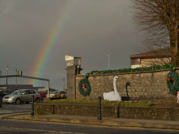 """A magical few seconds captured in West End this morning as the wonderfully colourful rainbow appeared to be projected by the """"snow projector"""" on the McCarthy-O'Leary pier - all for our Millstreet Christmas Swan!  Click on the image to enlarge.  (S.R.)"""
