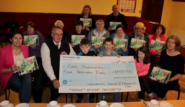 Following the annual 24 hour fast in October Dromtariffe Parents & Friends presented a hugely impressive cheque of €4,000.00 to COPE Foundation, Cork at an uplifting event in Dromtariffe Community Hall on Thursday, 10th Dec. 2015. Click on the images to enlarge. (S.R.)