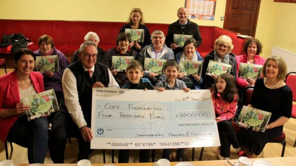 Front row (from left): Caitríona Buckley, Treasurer, Dromtariffe Parents & Friends Association; John Clifford, Head of Fundraising, COPE Foundation, Cork - accepting the cheque from Loreen Fitzpatrick, Secretary. Also included (centre, second row) Annmarie Murphy, Chairperson.
