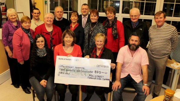 Following the recent superbly successful Fianna Fáil Quiz at McCarthy's Bar, Millstreet - a very impressive cheque for €875.00 was presented to St. Joseph's Community Hospital, Millstreet.  Accepting the cheque - Noreen McSweeney,  Acting Director of Nursing (seated second from left) from Margaret Fitzgerald, Quiz Coordinator supreme.  Also included at the presentation event in the Hospital on 8th Dec. 2015 were Cllr. Bernard Moynihan and John O'Leary - Organisers of the splendid fundraising event.   Click on the image to enlarge.  (S.R.)