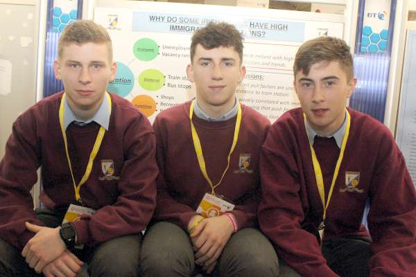 Shane Hickey, James Cronin and Padraig Moynihan with their project on 'Why do some Irish towns have high immigrant populations?'