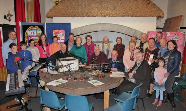 "Jimmy Reidy's wonderfully popular ""Round the Fireside"" series tonight places focus on the upcoming Bealtaine Festival in Duhallow.  As noted in our photograph (which was taken by Photographer Supreme - Sheila Fitzgerald) lots of local inputs in the programme which begins at 9.50pm and ends at 11.00pm.  A second programme has also been recorded at Freemount's Heritage Centre which will be broadcast on Monday, 23rd May 2016 at 9.50pm.  Do enjoy the splendid blend of chat, music, song and poetry in tonight's transmission.  The Show has also been recorded by William Fitzgerald for later transmission on LTV2 Millstreet.  Click on the image to enlarge."