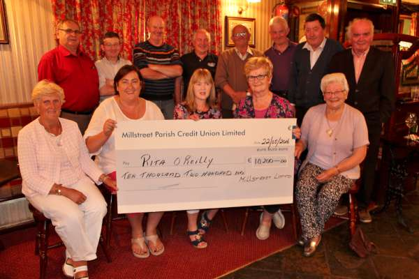 "Rita O'Reilly of Cloghoulabeg, Millstreet (seated centre) was presented with her most impressive cheque of €10,200.00 by the offers and members of the Millstreet Lotto Committee on Monday night (6th June 2016) at ""The Clara Inn"". Also included is proprietor, Ursula Pomeroy (seated on extreme left). Rita also won the Seller's Prize. Sincere congratulations to Rita and indeed to the Lotto Committee who so very dedicatedly coordinate the weekly Draw - all in a voluntary capacity. The funds have been such an enormous assistance to many local Organisations. Click on the images to enlarge. (S.R.)"