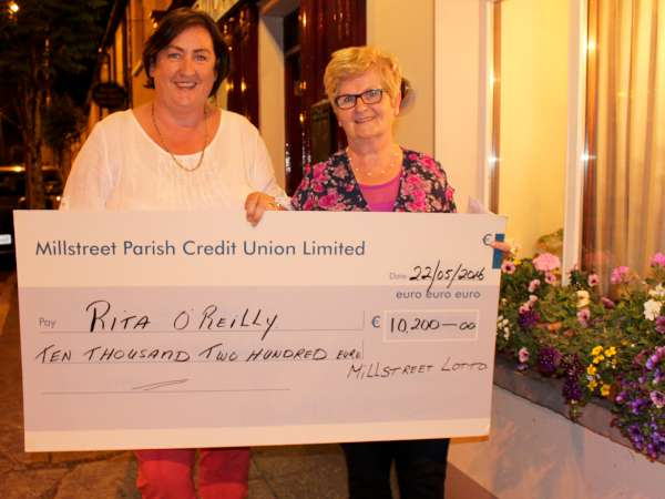 Treasurer, Millstreet Local Lotto - Marie Twomey pictured with Margaret Bourke - P.R.O. Lotto Committee - in advance of presenting the marvellous cheque to lucky Rita O'Reilly.