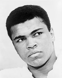 When in the 1970s I was visiting relatives in Surrey I went to visit the headquarters of the BBC and just happened to be at the Reception Desk when I became aware of an exciting group of people entering the front door of the famous building.  I couldn't believe it when I became aware that it was the great Muhammad Ali with his entourage and supporters arriving to participate in a television interview.  I so regretted not having had a camera with me on such an historic occasion but the memory is so precious.   We offer our sincere sympathy to all of his family, friends and fans on the sad departure of this truly great and charismatic gentleman and sportsman to his Eternal Reward.  (S.R.)
