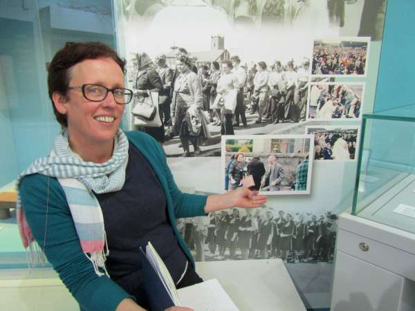 Knock MuseumCurator, Grace Mulqueen points out the direct Millstreet link. The prestigious Wall of Past Pilgrims over the Decades includes the late Eily Mae and William McSweeney of Flintfield who are seen on a 1960s Pilgrimage to Knock. Grace was delighted to discover who the people were as it is one of the Museum's treasured images. Click on the pictures to enlarge. (S.R.)