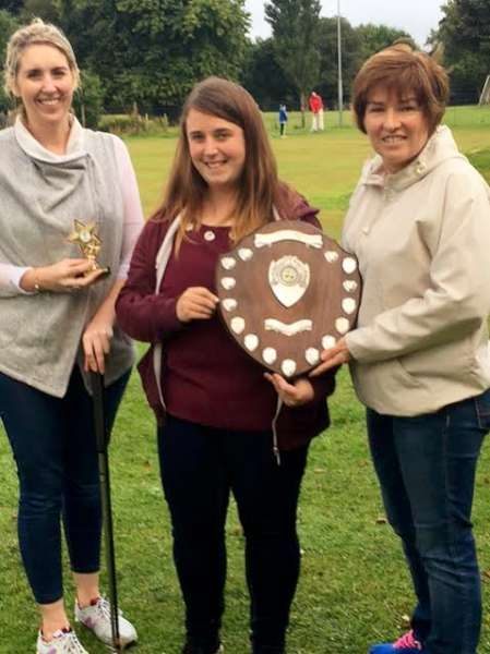 Paula O'Shea presenting the Paula O'Shea Shield to winner Deirdre Looney with Mairead Reen who was runner up.