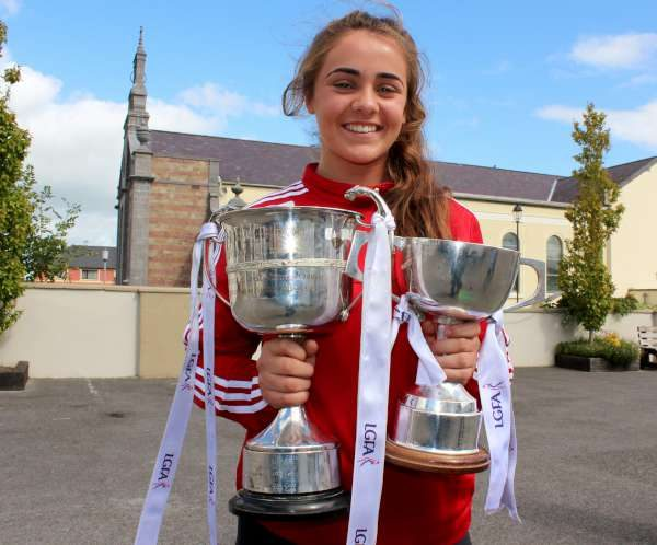 Chloe Collins was one of three Cork All Ireland Minor Football Under 18 Winners 2016 to visit National Schools throughout Duhallow and Sliabh Luachra on Friday, 2nd Sept. 2016. Pictured here with the Munster and All-Ireland Cups at Presentation N.S., Milllstreet. Click on the images to enlarge. (S.R.)