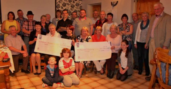 "Two very impressive cheques of €1050.00 were presented to Millstreet and Macroom Community Hospitals at ""The Pub"" in Carriganima on Saturday, 8th Oct. 2016 - the wonderfully fruitful result of the fourth annual Walk/Run/Jog held recently which was officially started by Cork Rose, Denise Collins and Liam Roche. It is Jimmy Murphy (pictured below) and his superb Committee must take great credit for organising such a splendid praiseworthy event which is becoming an annual Autumn tradition in Carriganima. Click on the images to enlarge. (S.R.)"